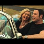 John Travolta and Olivia Newton-John Make New Creepy Christmas Song with Video
